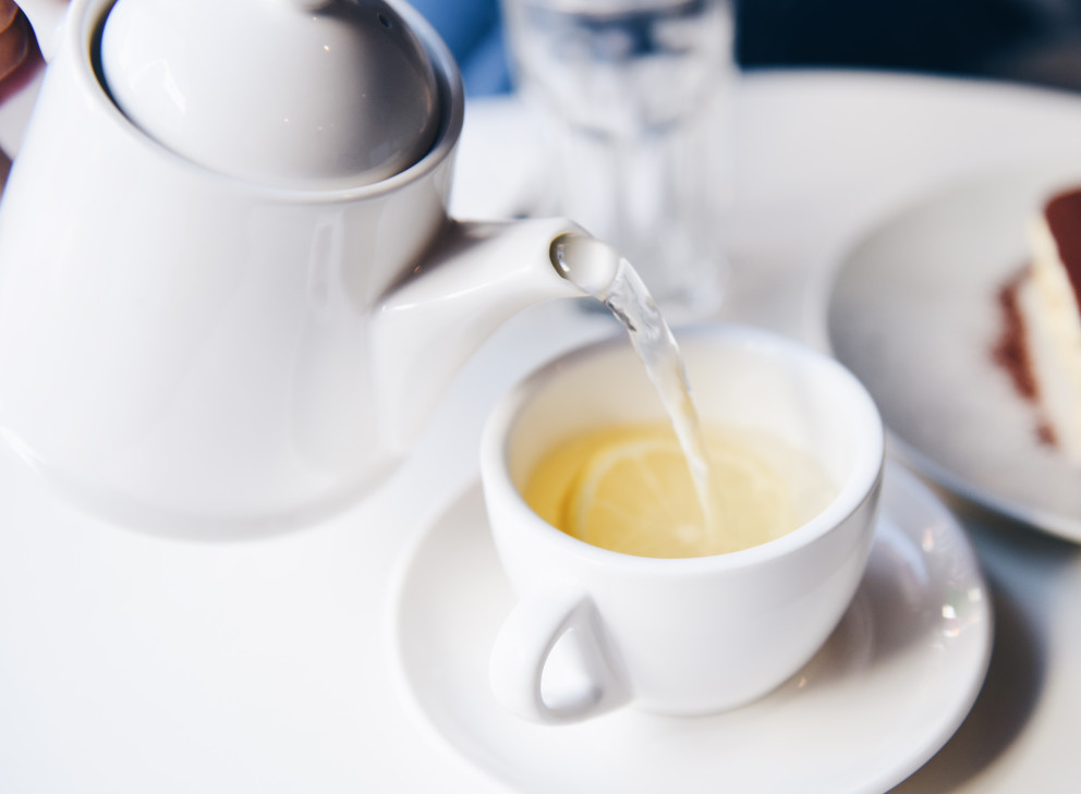 cup of tea being poured from a pot breakfast menu