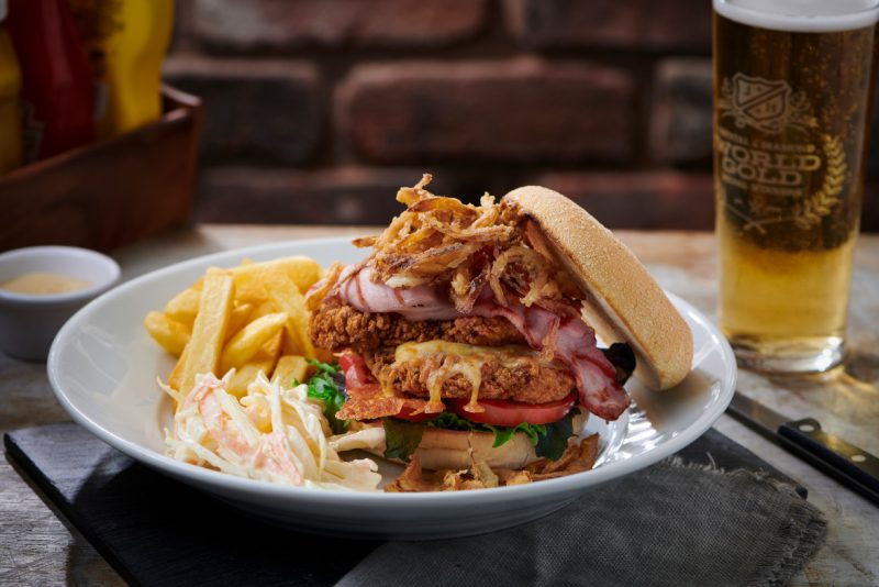 big chicken burger with chips and coleslaw