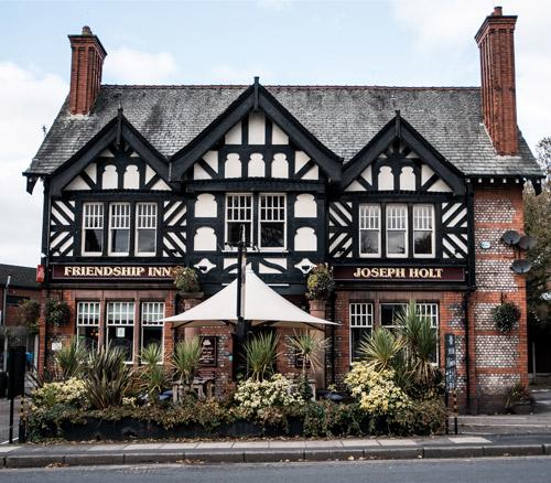 friendship inn outside of large pub in prestwich