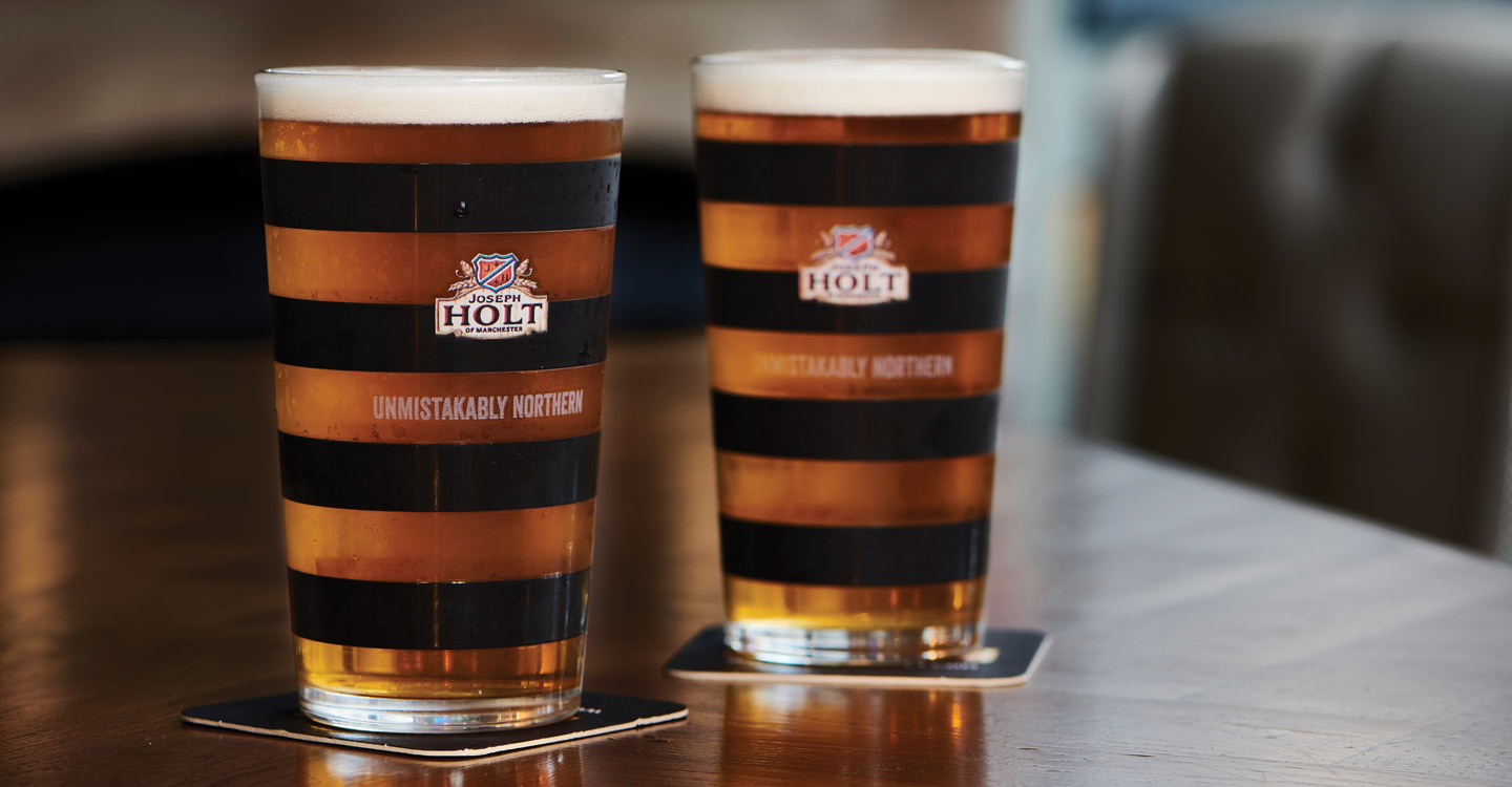 two pints of Northern Hop in manchester bee glass on a table
