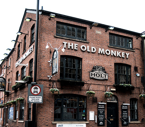 the old monkey pub in manchester corner of portland street