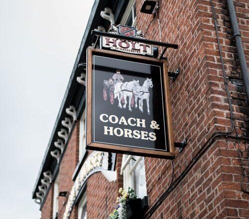 coach and horses pub sign