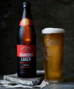 Diamond Lager Bottle with pint glass of beer