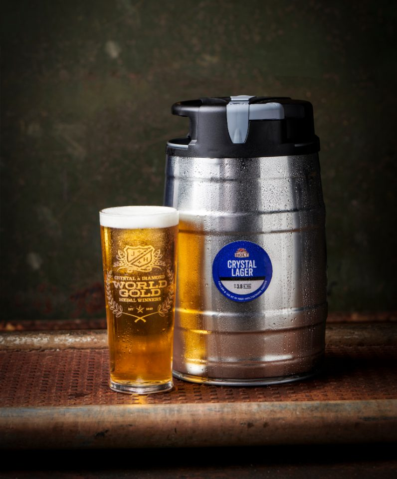 Crystal Lager mini keg with full pint glass of beer