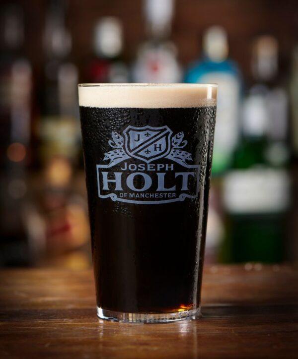 trailblazer stout joseph holt stout pint glass on bar